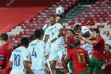 Portugal players Joao Cancelo (R) and Danilo in action against France's Presnel Kimpembe (C) during their UEFA Nations League group 3 soccer match held at Luz Stadium, in Lisbon, Portugal, 14 November 2020.