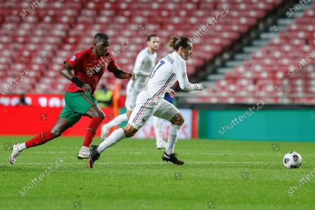 Portugal's William Carvalho (L) in action against France's Antoine Griezmann (R) during their UEFA Nations League group 3 soccer match held at Luz Stadium, in Lisbon, Portugal, 14 November 2020.