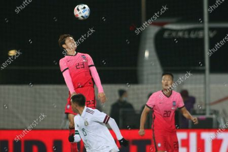 South Korea's Ju Se Jong, top, heads the ball past Mexico's Carlos Rodriguez during the international friendly soccer match between Mexico and South Korea at the SC Wiener Neustadt stadium in Wiener Neustadt, Austria