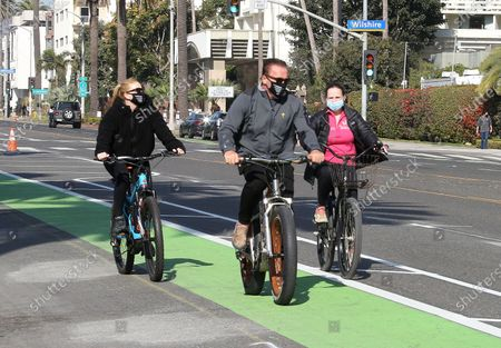 Arnold Schwarzenegger seen riding bikes with Heather Milligan in Santa Monica