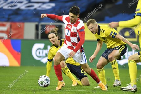 Croatia's Josip Brekalo (C) with the ball followed by Sweden's Kristoffer Olsson and Sebastian Larsson during the UEFA Nations League group match between Sweden and Croatia at Friends Arena in Stockholm, Sweden, 14 November 2020.