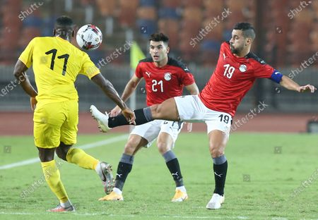 Egyptian player Abdallah El Said (R) in action against Togo player Gilles Sunui (R) during the Africa Cup of Nations qualification soccer match between Egypt and Togo at Cairo Stadium in Cairo, Egypt, 14 November 2020.