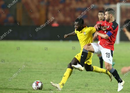 Stock Photo of Egyptian player Abdallah El Said (R) in action against Togo player Ihlas Bbou (L) during the Africa Cup of Nations Qualification soccer match between Egypt and Togo at Cairo Stadium in Cairo Egypt, 14 November 2020.