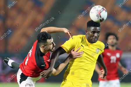 Stock Picture of Egyptian player Mahmoud Hamdy (L) in action against Togo player Paniel Mlapa (R) during the Africa Cup of Nations Qualification  soccer match between Egypt and Togo at Cairo Stadium in Cairo Egypt, 14 November 2020.