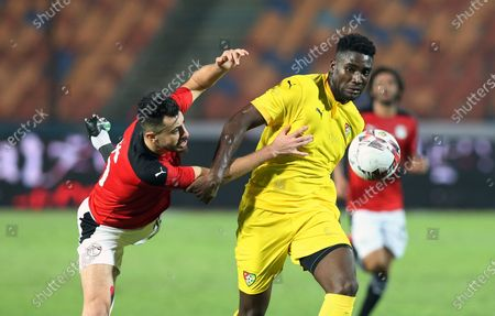 Egyptian player Mahmoud Hamdy (L) in action against Togo player Paniel Mlapa (R) during the Africa Cup of Nations Qualification  soccer match between Egypt and Togo at Cairo Stadium in Cairo Egypt, 14 November 2020.