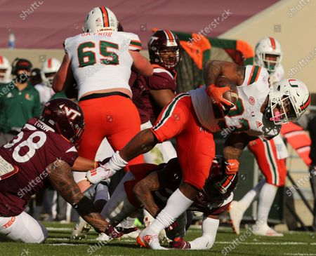 Stock Image of Miami's Cam'Ron Harris scores a touchdown past the Virginia Tech defense during the second half of an NCAA college football game, in Blacksburg, Va