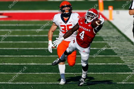Stock Photo of Rutgers running back Aaron Young (4) can't make a catch in front of Illinois linebacker Jake Hansen (35) during the first half of an NCAA college football game, in Piscataway, N.J. Illinois won 23 - 20