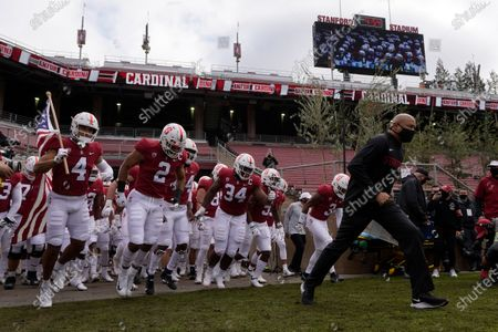 Stock Picture of Stanford head coach David Shaw, right, leads his team onto the field before an NCAA college football game against Colorado in Stanford, Calif