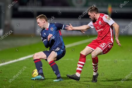 Stock Photo of Billy McKay of Ross County and Keiran Moore of Stirling Albion battle in midfield