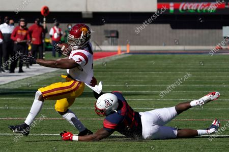 Arizona linebacker Jalen Harris (49) tackles Southern California running back Stephen Carr (7) in the first half during an NCAA college football game, in Tucson, Ariz