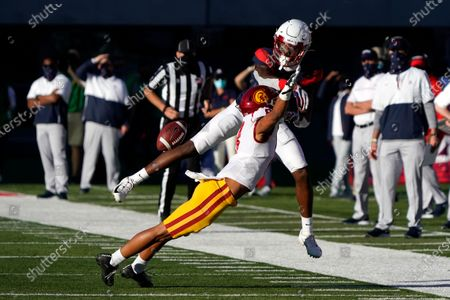 Southern California cornerback Chris Steele (8) knocks the ball away from Arizona wide receiver Boobie Curry (2) in the second half during an NCAA college football game, in Tucson, Ariz