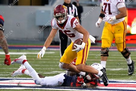 Stock Picture of Southern California wide receiver Drake London (15) tries to get away from Arizona defensive back Quinn Sullivan (30) after a catch during the second half of an NCAA college football game, in Tucson, Ariz. Southern California won 34-30