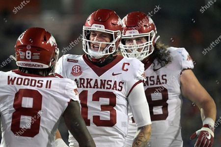 Arkansas quarterback Feleipe Franks (13) reacts after throwing for a 47-yard touchdown to wide receiver Mike Woods (8) during the first half of the team's NCAA college football game against Florida, in Gainesville, Fla