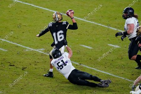 Purdue quarterback Aidan O'Connell (16) tries to throw as he's tackled by Northwestern linebacker Blake Gallagher (51) during the fourth quarter of an NCAA college football game in West Lafayette, Ind., . Northwestern defeated Purdue 27-20