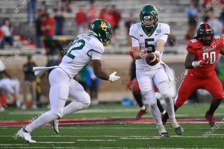 Stock Picture of Baylor quarterback Charlie Brewer (5) hands off to running back Taye Williams (22) during the second half of the team's NCAA college football game against Texas Tech in Lubbock, Texas