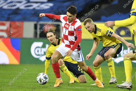 Croatia's Josip Brekalo with the ball followed by Sweden's Kristoffer Olsson and Sebastian Larsson during UEFA Nations League group A3 game between Sweden and Croatia at Frends Arena