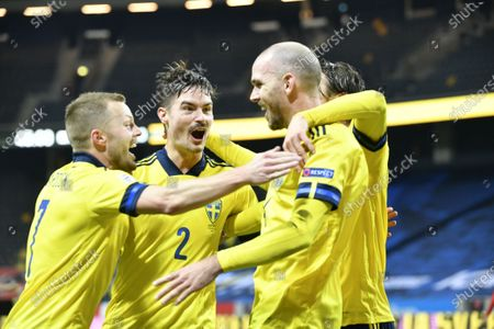 Stock Picture of Swedens Marcus Danielson scores his teams second goal and celebrate with Sebastian Larsson (L) and Mikael Lustig (C) during UEFA Nations League group A3 game between Sweden and Croatia at Frends Arena
