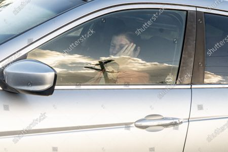Stock Picture of A woman cries in her locked car as protesters approach during the march for justice for 15 year old Quawan Charles who disappeared and was found dead near Loreauville, Louisiana.