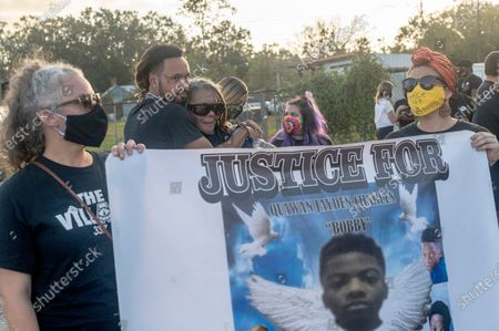 Protesters march from City Hall to the Police Station during the march for justice for 15 year old Quawan Charles who disappeared and was found dead near Loreauville, Louisiana.