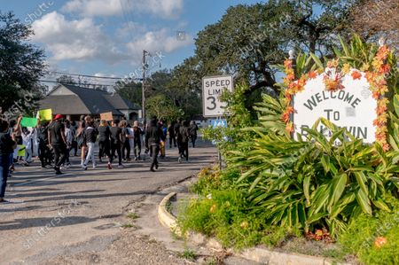 Protesters march from the Police department to city hall during the march for justice for 15 year old Quawan Charles who disappeared and was found dead near Loreauville, Louisiana.