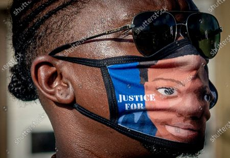 A mask bearing the likeness of Quawan during the march for justice for 15 year old Quawan Charles who disappeared and was found dead near Loreauville, Louisiana.