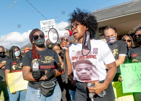 Protesters listen to speeches at city hall during the march for justice for 15 year old Quawan Charles who disappeared and was found dead near Loreauville, Louisiana.