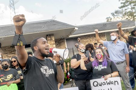 Devon Norman of The Village 337 leads protesters in song at  city hall during the march for justice for 15 year old Quawan Charles who disappeared and was found dead near Loreauville, Louisiana.