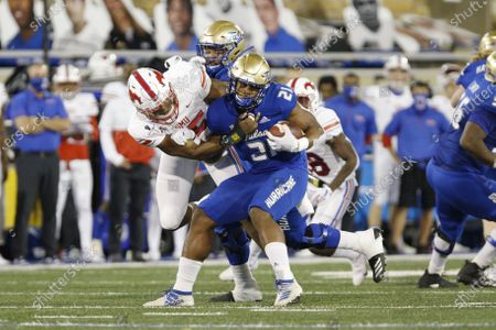 Defensive end Gary Wiley (55) wraps up Tulsa running back T.K. Wilkerson (21) during the first half of an NCAA college football game in Tulsa, Okla