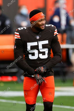 Cleveland Browns linebacker Tae Davis (55) warms up before an NFL football game against the Las Vegas Raiders, in Cleveland