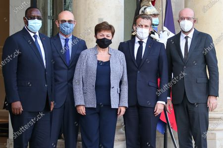 Stock Photo of French President Emmanuel Macron (2R) welcomes Senegal's President Macky Sall (L), head of the Peace Forum Pascal Lamy (2L), International Monetary Fund Managing Director Kristalina Georgieva (C) and European Council President Charles Michel (R) for The Paris Peace Forum at The Elysee Palace