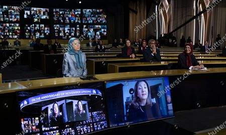 Stock Image of Mrs. Maryam Rajavi, the President-elect of the National Council of Resistance of Iran (NCRI), listens to Ingrid Betancourt, the former Columbian senator and Presidential candidate, during an online conference on the anniversary of the November 2019 uprising in Iran. Dozens of lawmakers and political personalities from Europe and the U.S. joined the conference.