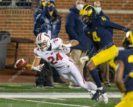 Stock Picture of Wisconsin wide receiver Adam Krumholz (24) misses a reception, defended by Michigan defensive back Vincent Gray (4) in the first quarter of an NCAA college football game in Ann Arbor, Mich