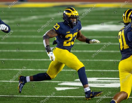 Michigan linebacker Michael Barrett (23) in action in the third quarter of an NCAA college football game against Wisconsin in Ann Arbor, Mich., . Wisconsin won 49-11