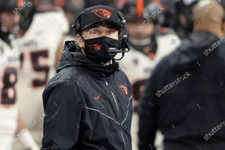 Oregon State coach Jonathan Smith looks toward the scoreboard during the first half of the team's NCAA college football game against Washington, in Seattle