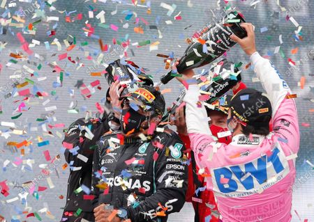 Mercedes' Lewis Hamilton, left, celebrates on the podium after winning the race with second placed Racing Point's Sergio Perez, right, and third placed Ferrari's Sebastian Vettel after the Turkish Formula One Grand Prix at the Istanbul Park circuit racetrack in Istanbul