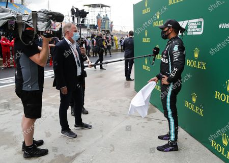 Stock Image of Martin Brundle, Sky TV, interviews Lewis Hamilton, Mercedes-AMG Petronas F1, after winning the race, to take his 7th World Championship title during the 2020 Formula One Turkish Grand Prix