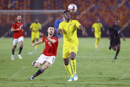 Mahmoud Hamdy (L) of Egypt competes during the 2021 Africa Cup of Nations qualification match between Egypt and Togo in Cairo, Egypt, on Nov. 14, 2020.