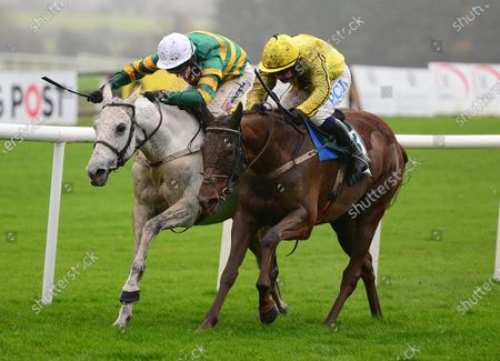 PUNCHESTOWN 15-November-2020. BUILDMEUPBUTTERCUP and Paul Townend (right) beats off ELIMAY (Mark Walsh) by a nose for owner John Turner and trainer Willie Mullins. Healy Racing