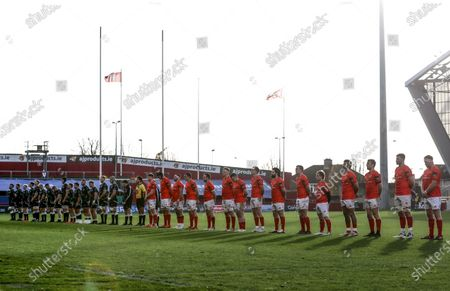 Stock Photo of Munster vs Ospreys. Munster players stand for a moments silence in remembrance for Munster colleague and friend John O'Neill, . During his time as a Rugby Development Officer the Waterford-man worked closely with the regional development squads and coached several of the current Munster squad including Jack O'Donoghue, Fineen Wycherley, Gavin Coombes, Liam Coombes, and the Academy's Tom Ahern and Eoin O'Connor, . Working closely with the schools and clubs across the province he also held the role of Munster Junior Head Coach for seven seasons