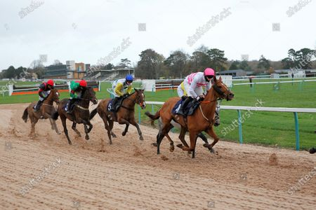 Jonjo O'Neill and Adicci [white/spots/yellow sleeves] at the All-Weather bottom bend before victory in the Paddy Power Salmon Spray Handicap Hurdle at Fontwell.