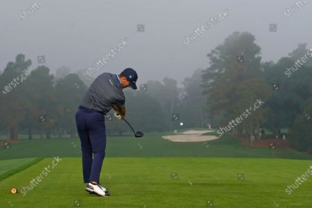 Stock Image of Billy Horschel tees off on the first tee during the final round of the Masters golf tournament, in Augusta, Ga