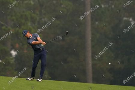 Stock Picture of Billy Horschel hits on the second fairway during the final round of the Masters golf tournament, in Augusta, Ga