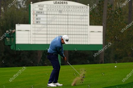 Lee Westwood, of England, hits on the third fairway during the final round of the Masters golf tournament, in Augusta, Ga