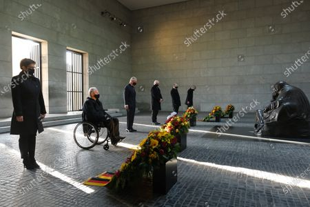 (L to R) German Defense Minister Annegret Kramp-Karrenbauer, Bundestag President Wolfgang Schauble, Prince Charles, German President Frank-Walter Steinmeier, Bundesrat President Reiner Haseloff and Federal Constitutional Court President Stephan Harbarth stand next to wreaths at the Neue Wache memorial to victims of war and tyranny. The British royal couple are in Berlin to attend events today on Germany's National Day of Mourning that commemorates victims of war and fascism.