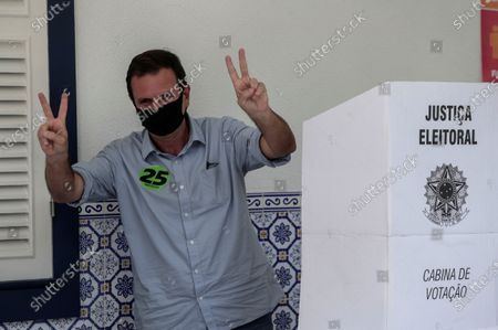 Eduardo Paes, candidate for Mayor of Rio de Janeiro, poses after voting at an electoral center in Rio de Janeiro, Brazil, 15 November 2020. The electoral colleges began to open their doors on 15 November at 7:00 am (10:00 GMT) in most of Brazil for the elections in which the mayors and councilors of 5,569 municipalities will be elected for the next four years.