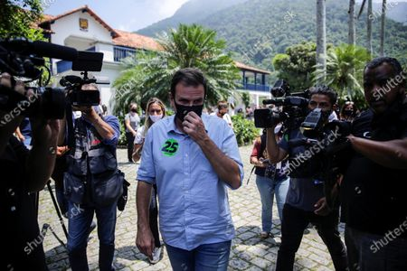 Eduardo Paes (C), candidate for Mayor of Rio de Janeiro, arrives to vote at an electoral center in Rio de Janeiro, Brazil, 15 November 2020. The electoral colleges began to open their doors on 15 November at 7:00 am (10:00 GMT) in most of Brazil for the elections in which the mayors and councilors of 5,569 municipalities will be elected for the next four years.