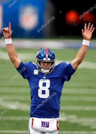 New York Giants quarterback Daniel Jones (8) reacts to a touchdown during an NFL football game against the Philadelphia Eagles, in East Rutherford, N.J