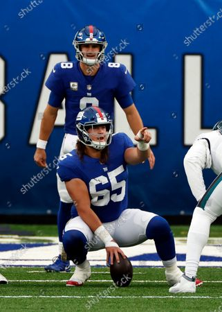 New York Giants center Nick Gates (65) signals in front of New York Giants quarterback Daniel Jones (8) during an NFL football game against the Philadelphia Eagles, in East Rutherford, N.J