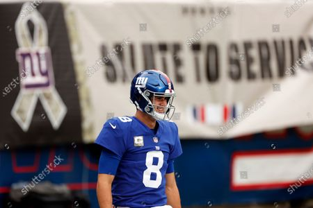 Stock Image of New York Giants quarterback Daniel Jones (8) warms up before an NFL football game against the Philadelphia Eagles, in East Rutherford, N.J