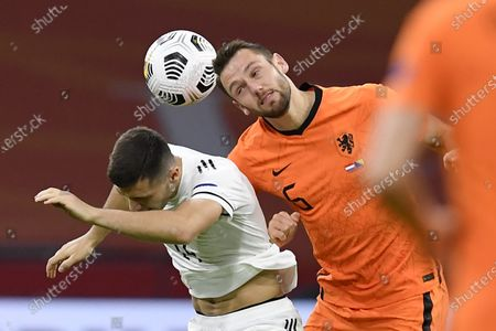 Bosnia and Herzegovina's Amer Gojak, left, and Netherlands' Stefan de Vrij head the ball during the UEFA Nations League soccer match between The Netherlands and Bosnia and Herzegovina at the Johan Cruyff ArenA in Amsterdam, Netherlands